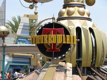 Tomorrowland Signage at Disneyland Park and Magic Kingdom