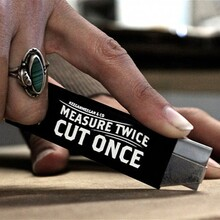 """Measure Twice, Cut Once"" box cutter"