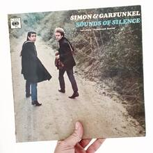 <cite>Sounds of Silence</cite> by Simon & Garfunkel