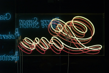 <cite>Thieves Like Us</cite> neon