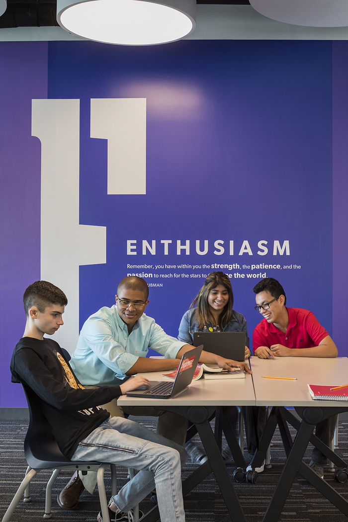 The stencil E for Enthusiasm is custom or from an unidentified typeface.