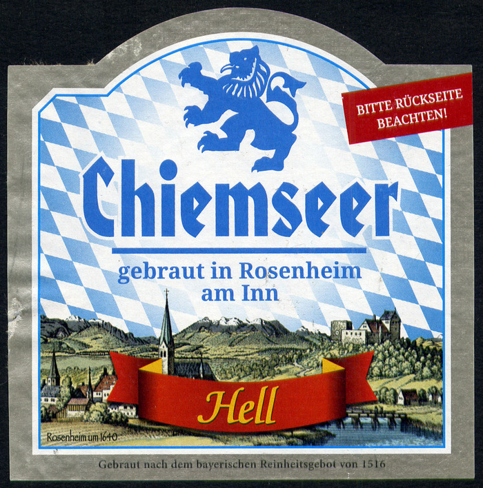 """Since June 2016, the beer comes with new labels. The name Chiemseer remained, but is now accompanied by a new image, a prominent disclaimer """"Gebraut in Rosenheim am Inn"""" (in ), and a pointer to see the reverse, which shows a map indicating the location of Rosenheim (about 25km west of the lake)."""