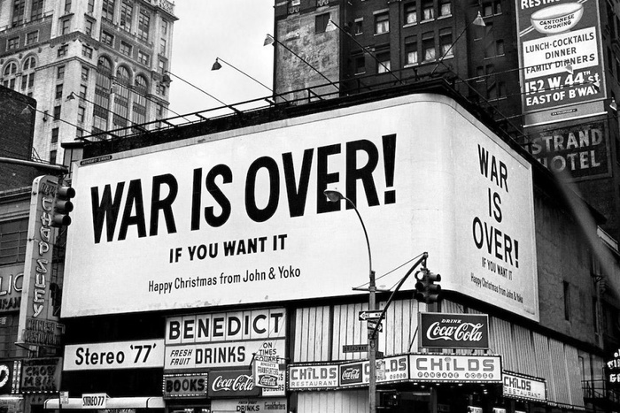 Times Square, New York City, December 1969. The text on this billboard is not set with type, but uses non-typographic lettering that was presumably more practical to apply at such a large scale.