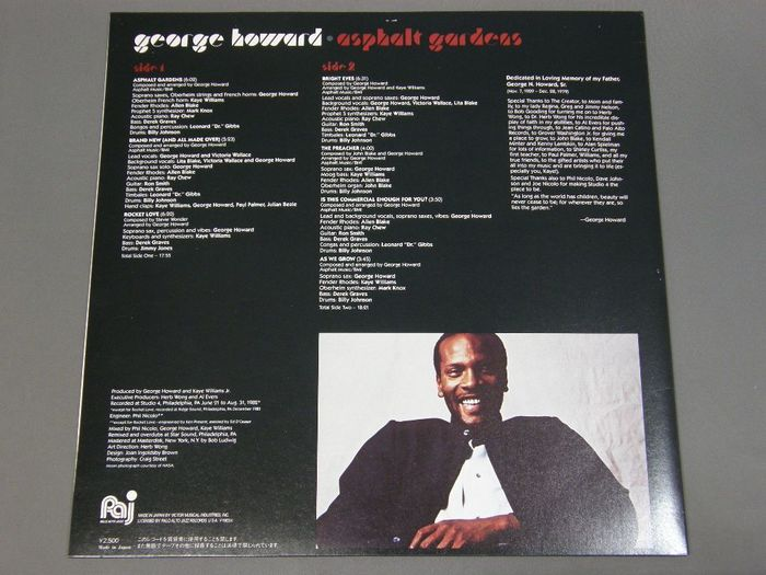 Back cover with track names and credits set in .