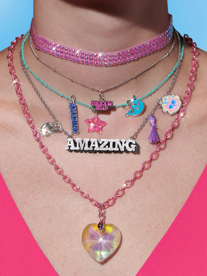 "Necklaces featuring  (""Dream Big"") and  (""Amazing"")."