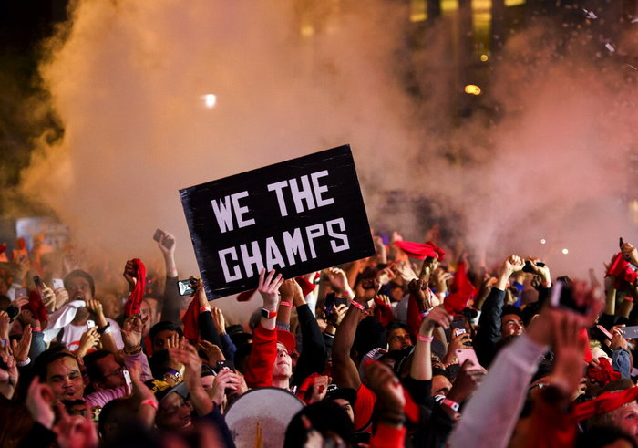 June 15, 2019: Toronto Raptors fans celebrate in Jurassic Park outside Scotiabank Arena in Toronto as the Raptors defeated the Golden State Warriors, 114-110, in Game 6 to win the NBA championship for the first time on Friday. (AP)