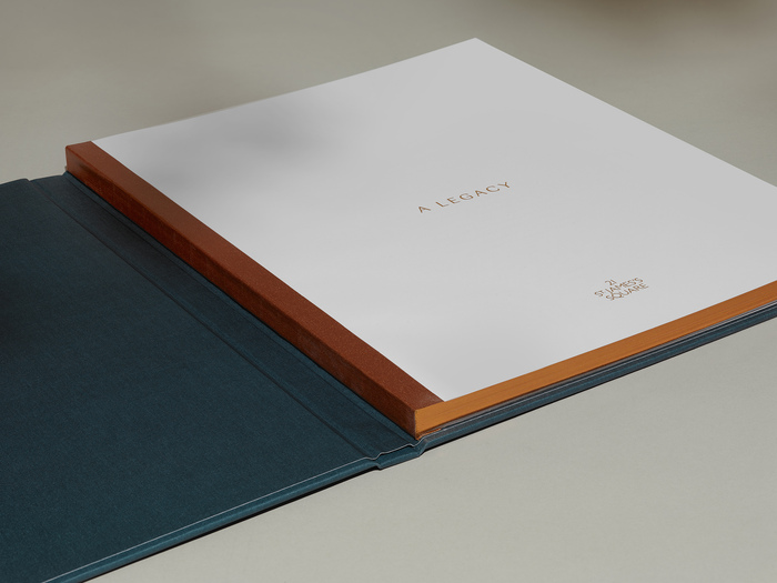 Inside front cover. Swiss bound with bronze tape and bronze edging.