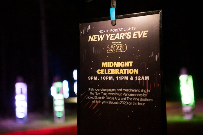 """Poster for the New Year's Eve party, featuring outlined and overlapping lining numerals from Halyard Display Black for """"2020""""."""