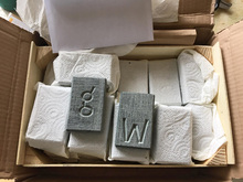 Art packages with chiseled letters