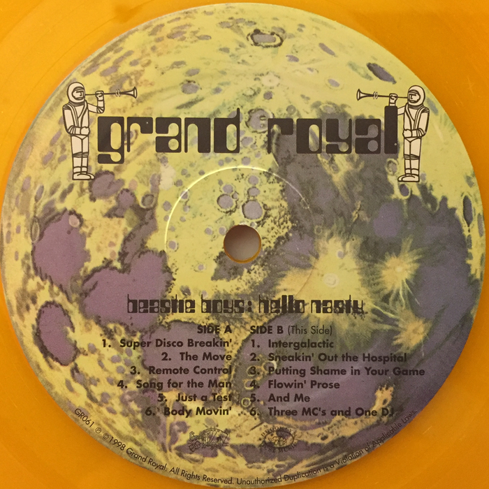 "Record label (Side B). ""Grand Royal"" features the same style of lettering, with a thin ascender for d. Unlike in Countdown, g is monocular. Two weights of  are used for the track list and the credits."