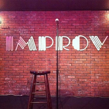 The Improv comedy club logo