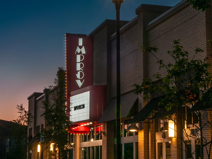 A vertical variant of the logo for the Improv in Raleigh.