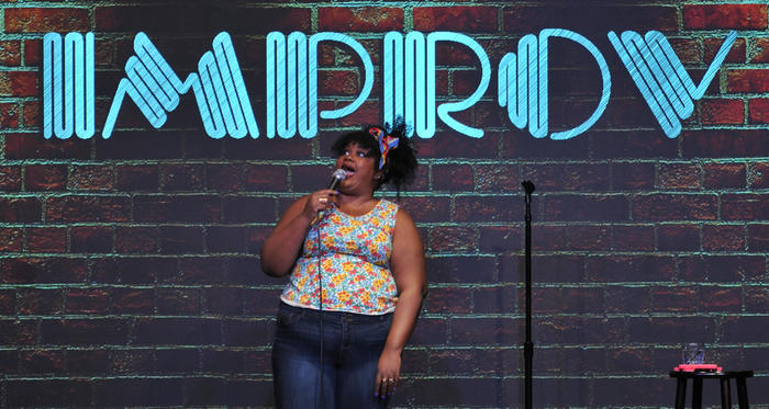 Nicole Byer on stage at the Improv in Raleigh.