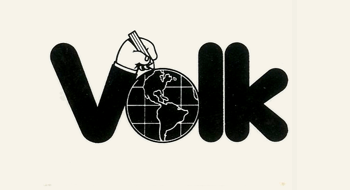 """Coinciding with the silver anniversary, Volk introduced a new logo, featuring rounded sans-serif letterforms. The right arm of V extends to a hand holding a pencil and drawing on the o, turning it into a globe. The Herb Lubalin Study Center points out that this logo was designed by  – """"not his greatest logo, but charming""""."""
