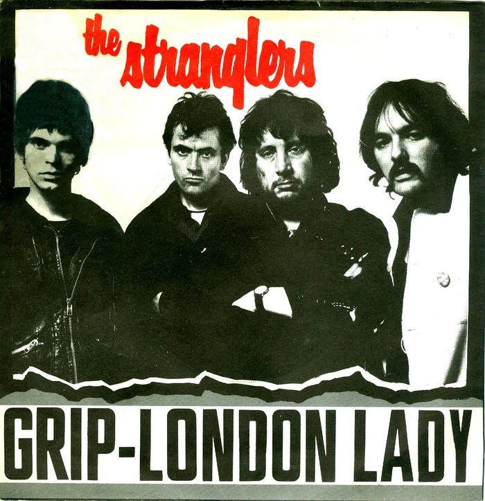 """Debut single """"Grip"""" with B side """"London Lady"""", United Artists Records (UK, Jan. 1977). Photo by Chris Gabrin. The angular sans serif used for the titles is ."""