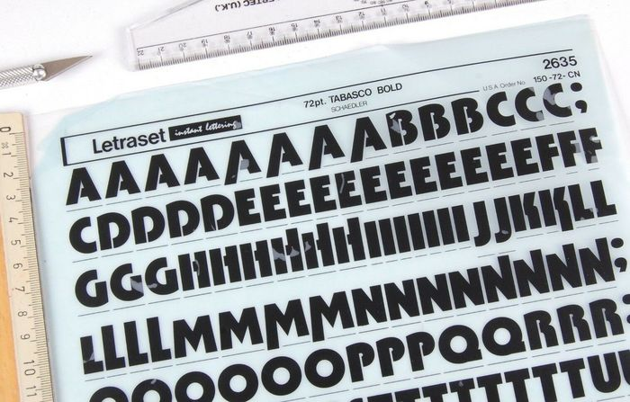 Detail of a dry-transfer lettering sheet showing the caps of Tabasco Bold. Originally released by  in New York, the phototype family spanned three weights (Light, Medium, Bold) plus a biline variant named . The Medium and Bold were adopted by Letraset in 1973/1974. Ascending/descending alternates were available for a range of letters.