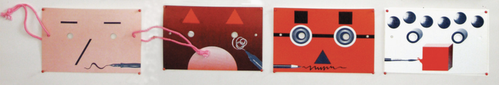 The postcards with string showing how they could be worn as a mask.