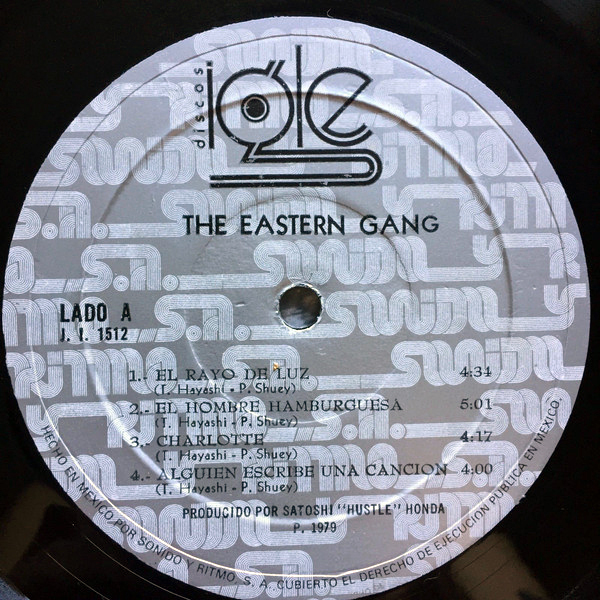 "The logo as seen on a record label by Discos Igle. ""The Eastern Gang"" is set in , the track list in ."