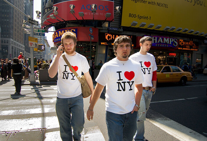 The T-shirts with the iconic logo can be found all over the world, from Times Square (2006) …