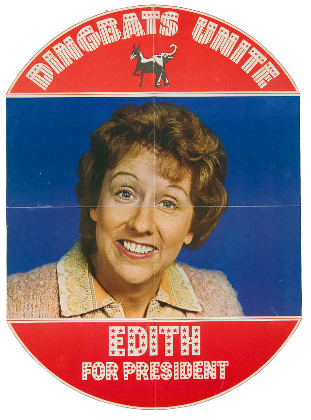 """17×23″ poster with full color portrait of Jean Stapleton surrounded by her Edith Bunker campaign slogan """"Dingbats Unite – Edith for President"""" and a janiform bipartisan donkeyphant. The typography uses two faces from Photo-Lettering's patriotic department,  and ."""
