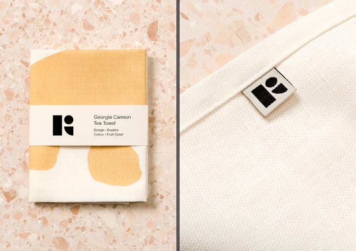 Tea towel packaging and logo mark detail.