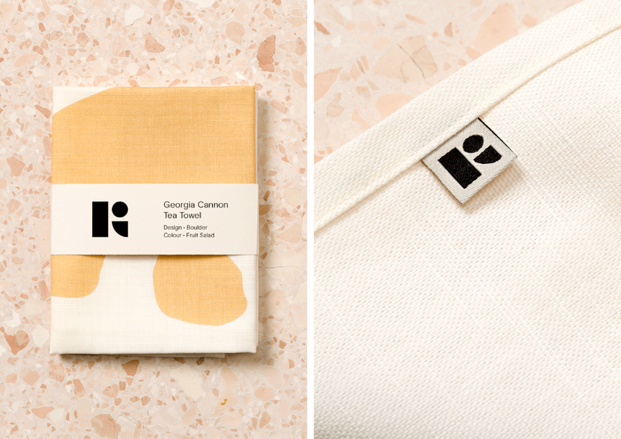 Tea towel packaging and logo mark detail.