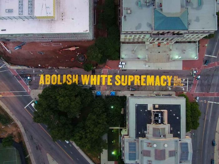 """ABOLISH WHITE SUPREMACY"" on Martin Luther King Jr. Boulevard, between the Essex County Courthouse and the Veteran's Courthouse."