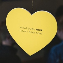 """What does your heart beat for?"" hanging hearts display"