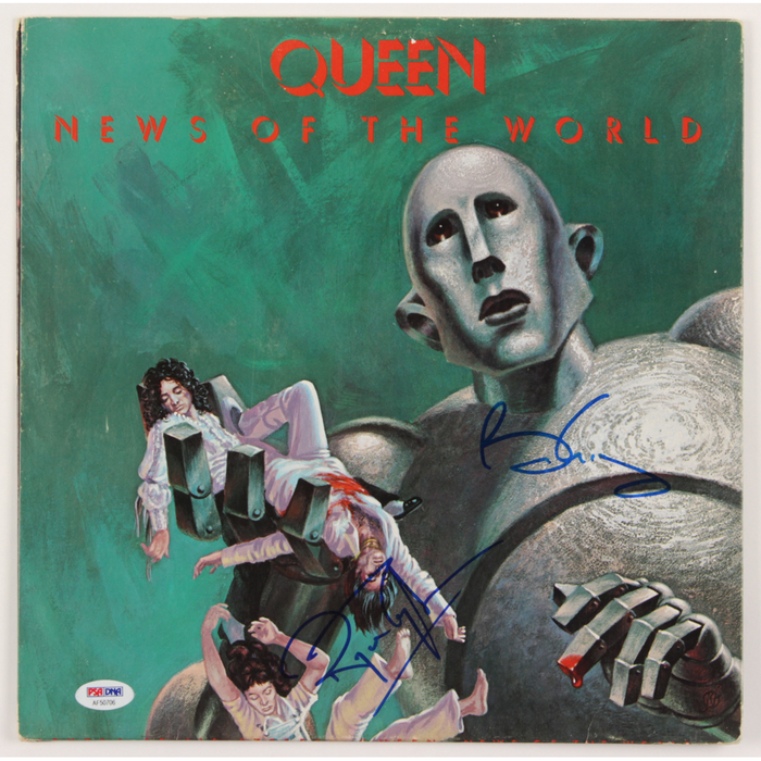 Front cover signed by Brian May and Roger Taylor.