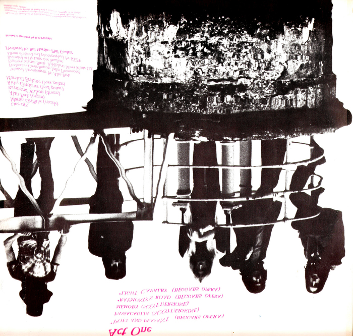 The opposite page shows a mirror image, with a darker version of the band portrait. The text is distorted as if it were reflected by the water surface.