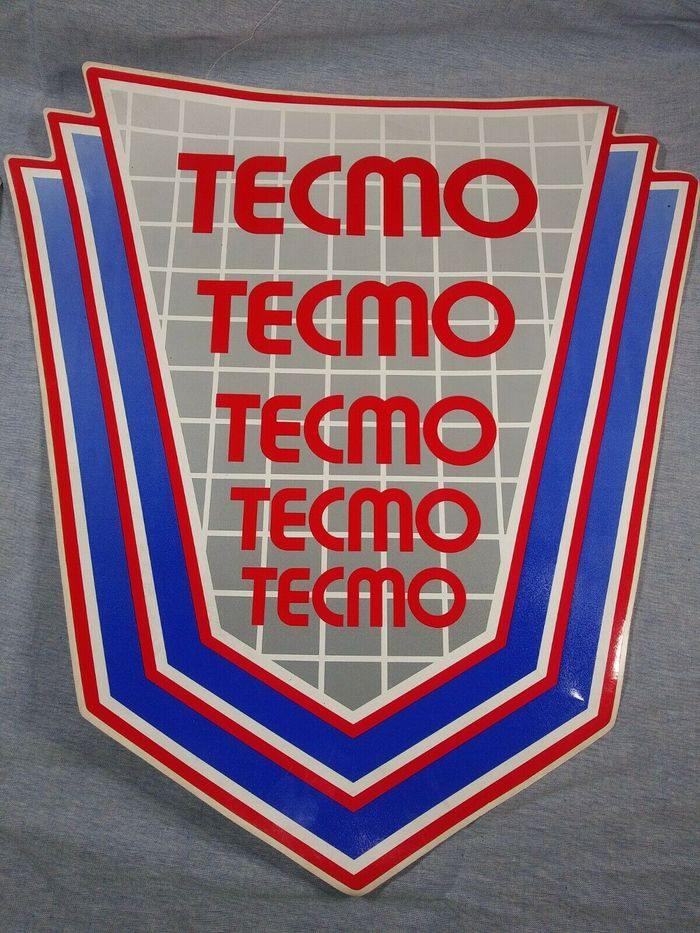 The Tecmo logo in multiple sizes, on the side art decal for a video arcade game cabinet.