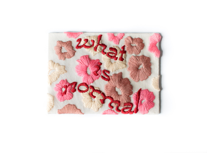 """Linny Inc. logo and """"what is normal"""" embroidery 1"""
