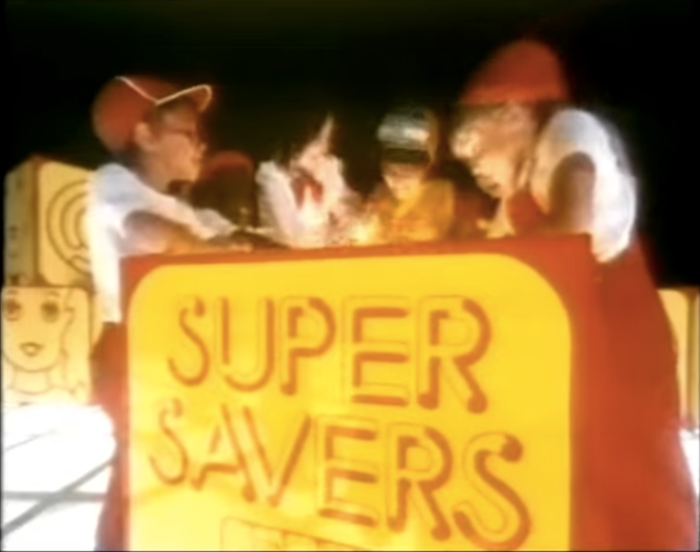 """""""Supersavers"""". Still from a TV commercial, 1983."""