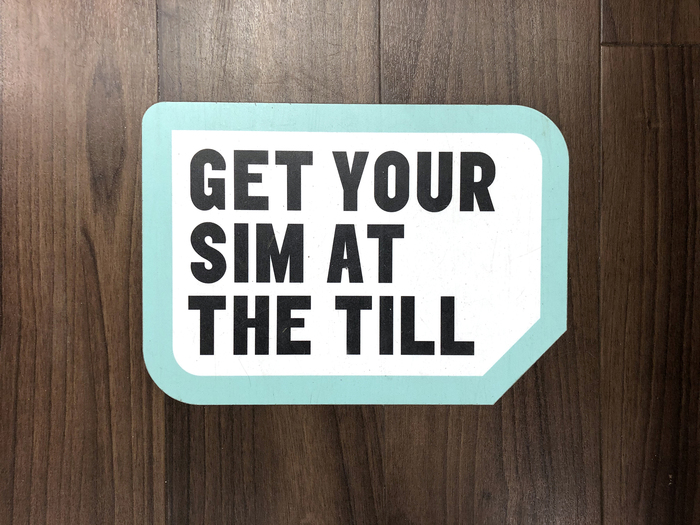 Sim-shaped floor display sticker