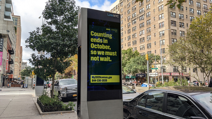 A LinkNYC kiosk with messaging in English