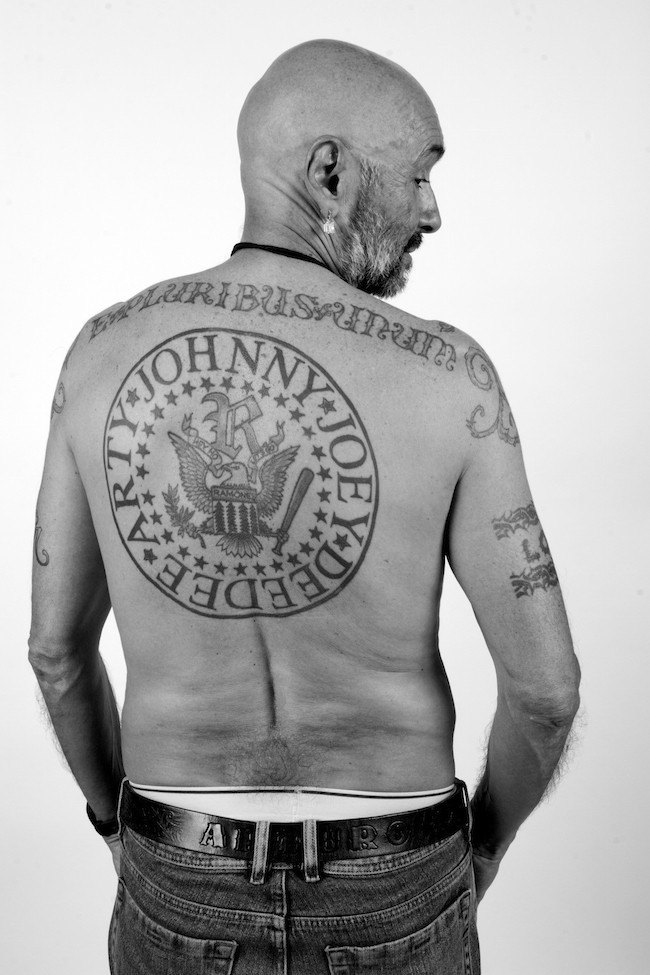 Arturo Vega had the logo tattooed on his back with his own name incorporated and a type style that is less stylized than Tiffany. That variant, like many similar variations seen today, more closely matches most contemporary incarnations of the presidential seal. (Photo by Curt Hoppe.)