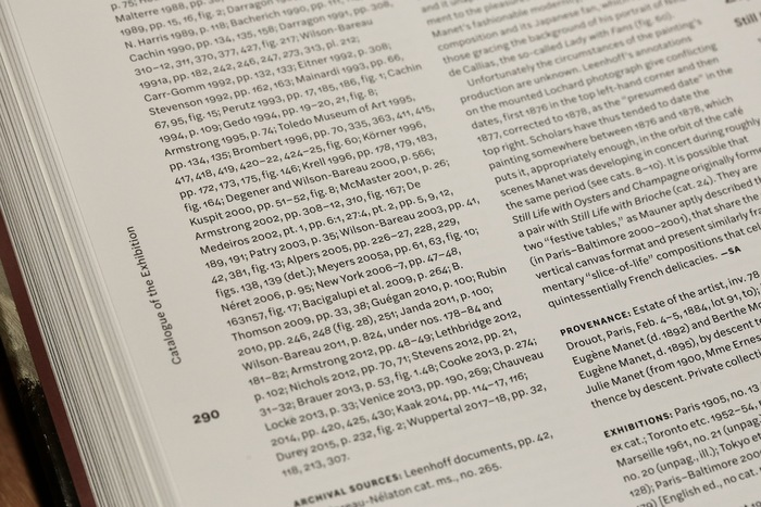 """Running titles are set vertically in the outer margins, echoing the rotated """"Manet"""" on the book jacket. Theinline headings are highlighted by the use of bold small caps."""