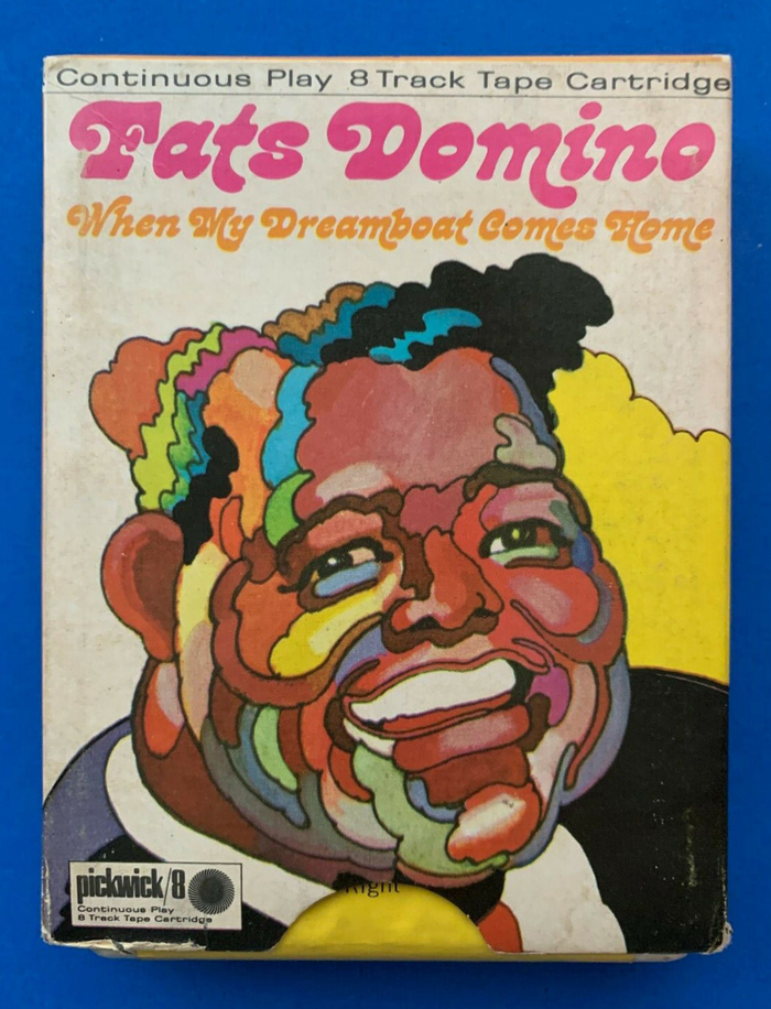 The cardboard sleeve to an 8-track tape cartridge offers less space than the cover for a 12″ vinyl record. Instead of scaling the illustration down beyond recognition, just a detail with Domino's face was used. The type was rearranged accordingly, too.