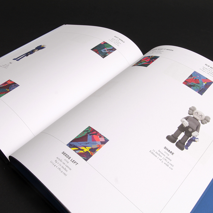 The typography is restrained and plays a supporting role to KAWS' artwork but is highly considered nonetheless.
