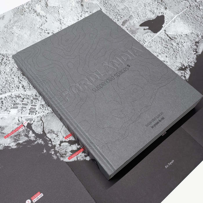 The book comes with a folded poster that serves both as a map and an index.