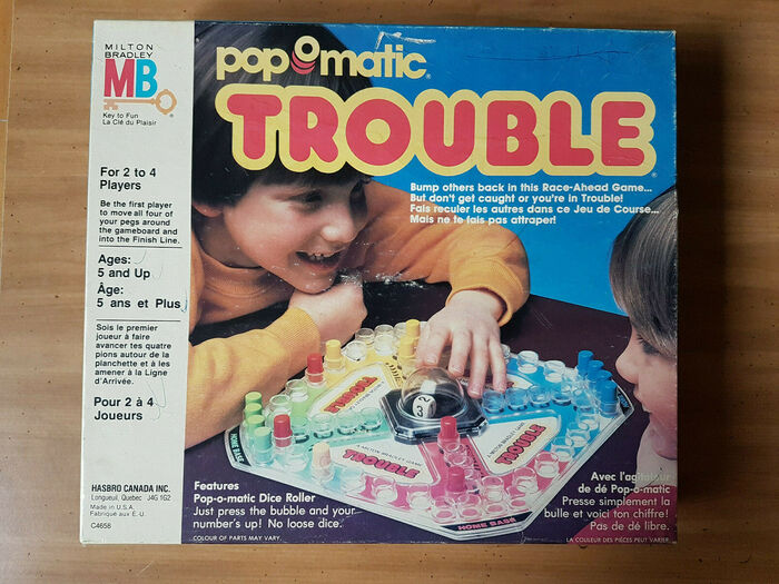 Trouble by Hasbro Canada Inc., 1986, with game instructions in English and French. The white text at  the bottom is set in .