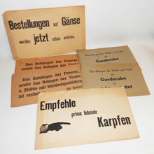 """Empfehle prima lebende Karpfen"" and other paper signs for restaurants"