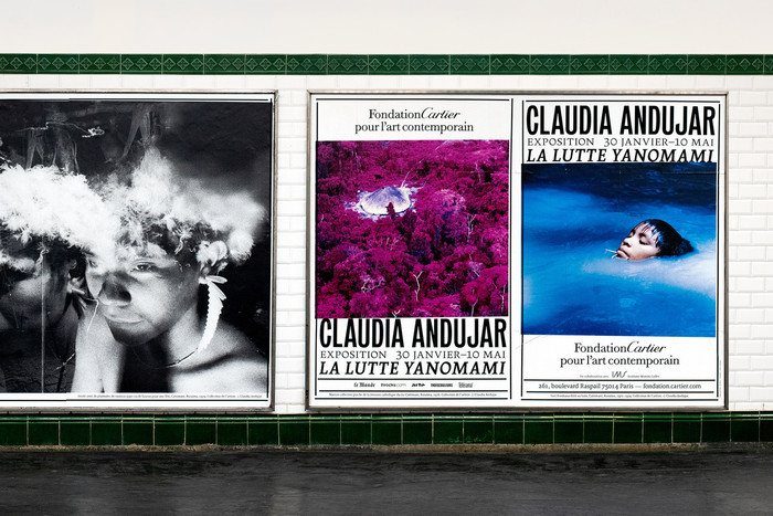 Exhibition posters in a Paris Métro station.