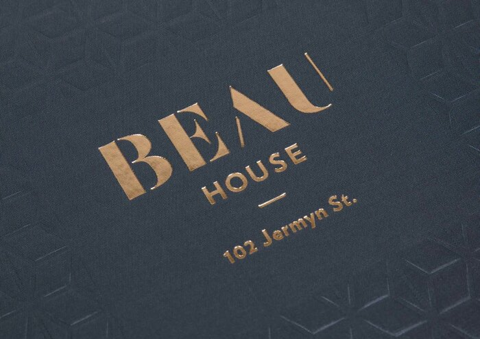 """""""BEAU"""" uses  in modified form, with added strokes in A and U. Smaller text set in Verlag."""