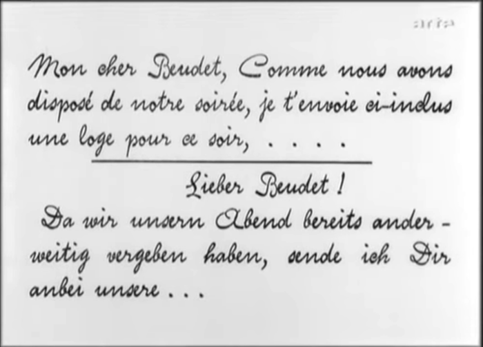 The text of a letter received by the husband is shown in (again bilingual) title cards, set in a script typeface that emulates handwriting.