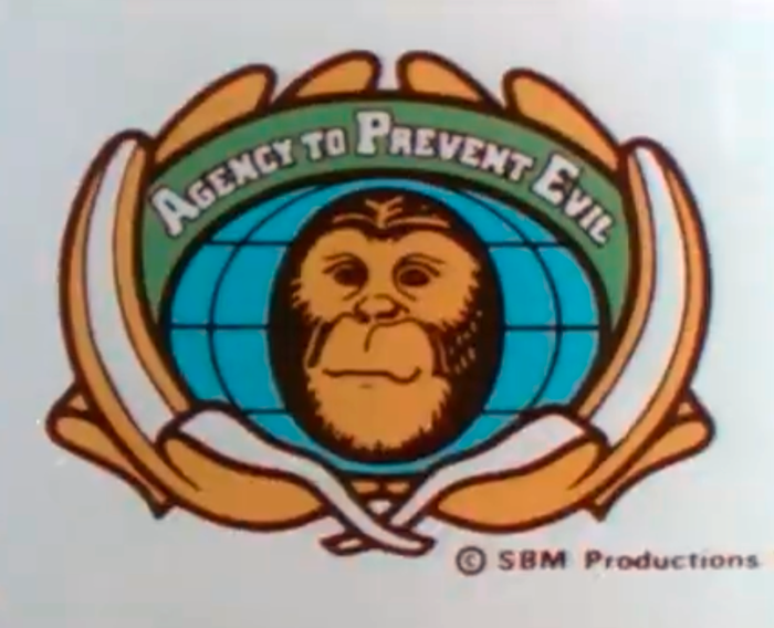 The Agency to Prevent Evil (A.P.E.) wordmark uses  Bold with faux small caps, set on a curve and framed by bananas.