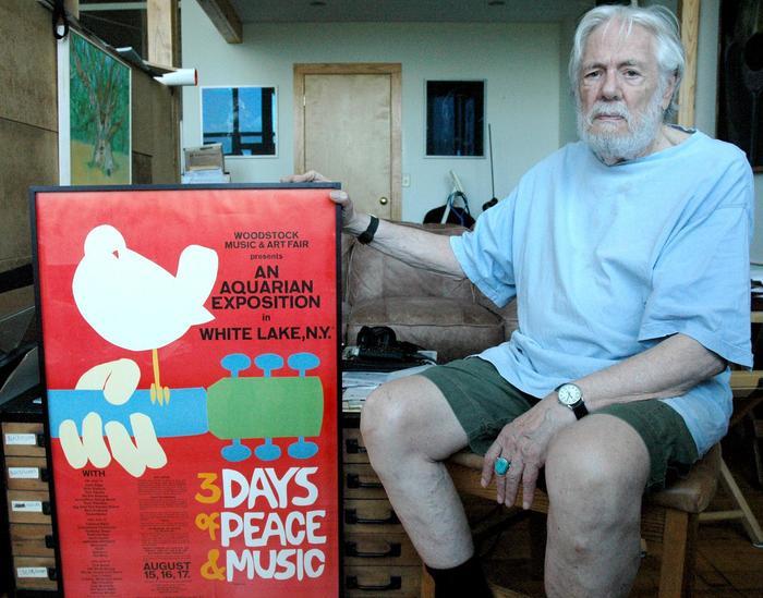 Designer Arnold Skolnick with his iconic Woodstock festival poster.