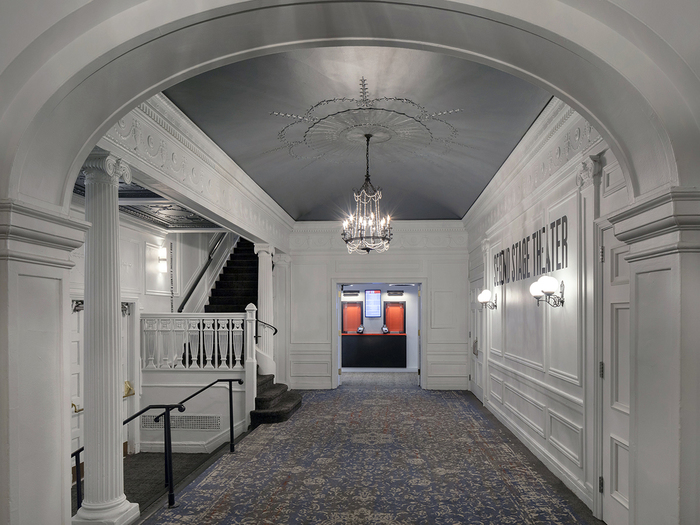 Helen Hayes theater — Lobby. Interior design by Rockwell Group. Type runs over the building's historic mouldings.