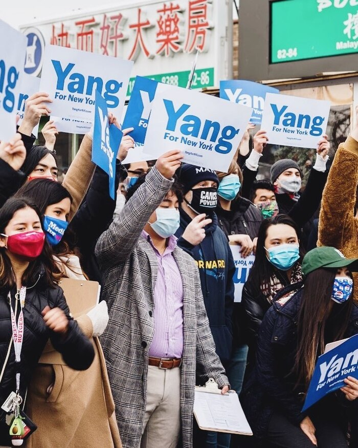 The Yang for New York logo as seen on paper signs at a rally.