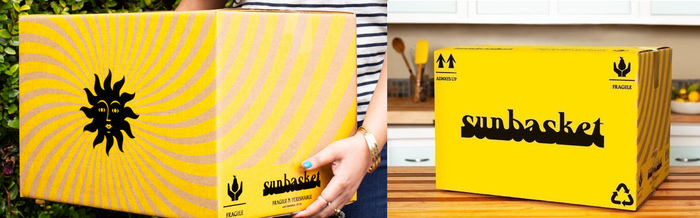 The delivery boxes use black and yellow and foreground the wordmark and the sun icon.